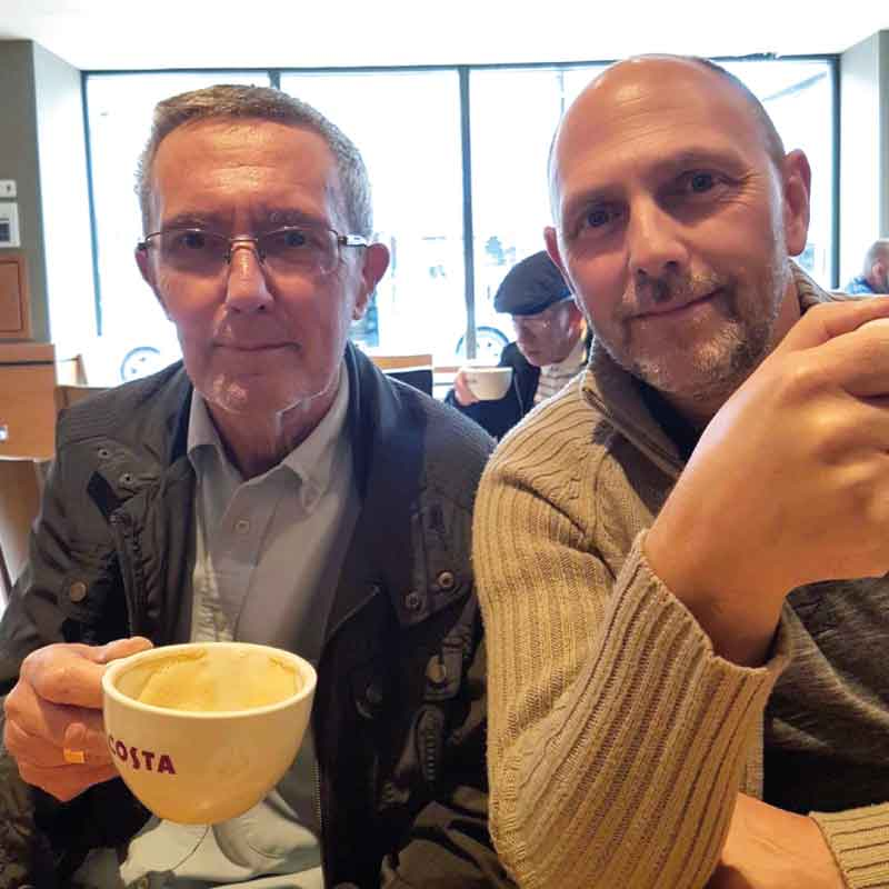 Simon and his dad drinking coffee